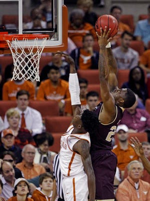 ULM forward Roderick Taylor, right, pulls down a rebound against Texas guard Jacob Young, left, during the first half of an NCAA college basketball game Monday.