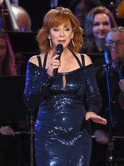 """FILE - This Nov. 2, 2016 file photo shows Reba McEntire performing during a tribute to Dolly Parton at the 50th annual CMA Awards in Nashville, Tenn. McEntire is releasing """"Sing it Now: Songs of Faith & Hope"""" on Feb. 3, a double album of inspirational and gospel music. She said the timing was right for her to focus on her faith after she and Narvel Blackstock announced in 2015 they were divorcing after 26 years of marriage."""