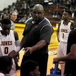 Jones County Junior College head coach Rahim Lockhart talks with his team during a timeout in a game against Itawamba. Lockhart, in his first year as Bobcat head coach, led the team to an 18-5 record.