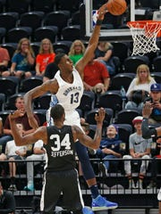 Memphis Grizzlies forward Jaren Jackson Jr. (13) goes to the basket as San Antonio Spurs' Cory Jefferson (34) watches during an NBA summer league game, July 5, 2018, in Salt Lake City.