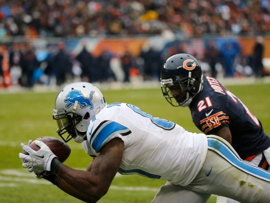Lions receiver Calvin Johnson catches a touchdown against Chicago Bears safety Ryan Mundy during the second half of an NFL football game, Sunday, Jan. 3, 2016, in Chicago.