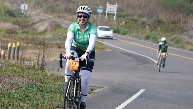 Marlin Campos, 32, of Simi Valley, took her doctor's advice and switched from being a marathon runner to cycling after she was diagnosed with osteoarthritis. She is currently riding in the Arthritis Foundation's California Coast Classic Bike Tour, a 570-mile, eight-day ride from San Francisco to Los Angeles. Here, she rides on the first leg from San Francisco to Santa Cruz on Highway 1. The riders are spending Friday night in Ventura.