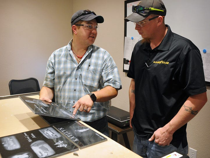 Austin Keesee, left, owner of Austin Stone and Monument,