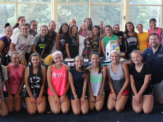 "The Lourdes field hockey team ""adopted"" Maui Lengyel,"