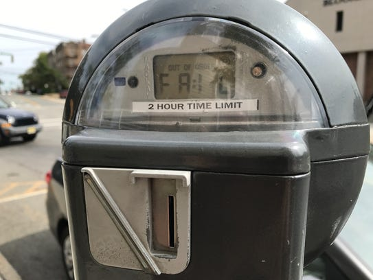 """A parking meter in Bloomfield reads """"fail."""" Bloomfield officials are considering new parking meters that will also allow patrons to pay via a cell phone application and with credit cards."""