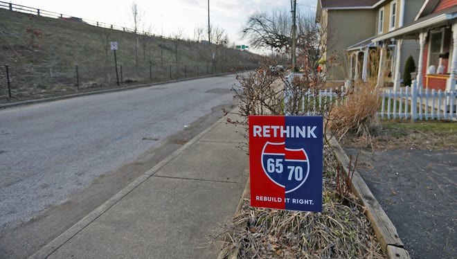 A Rethink 65/70 sign is seen on Davidson St., right next to the highway, Tuesday, March 13, 2018. Owners of Ralph's Great Divide, at 743 E. New York St., (parking lot seen here) worry about the effect on their business of the proposed rebuild of the I-65/I-70 north split.
