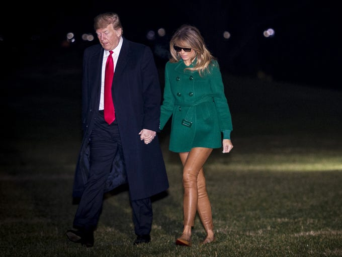 First lady Melania Trump and President Trump return