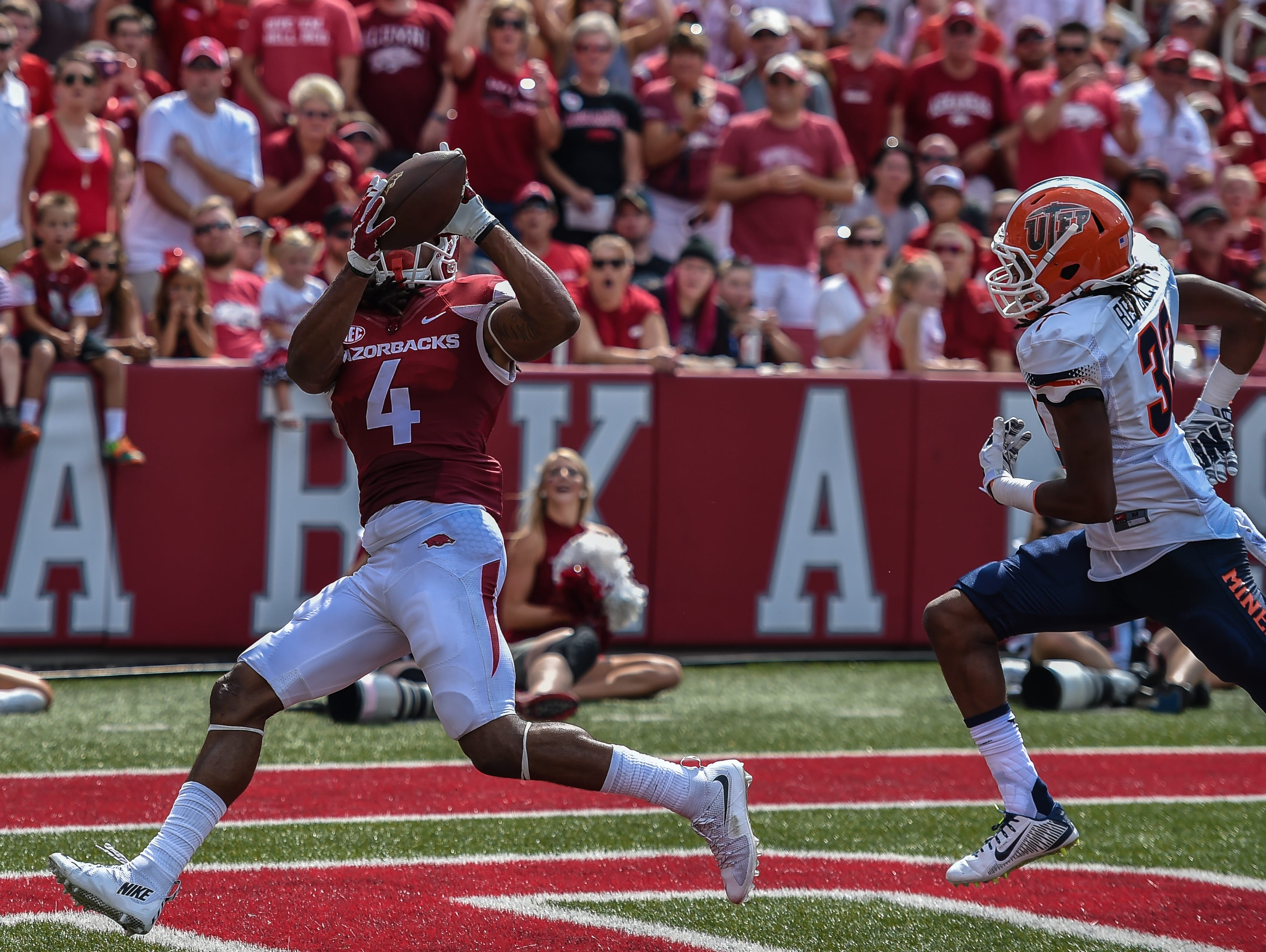 Arkansas Razorbacks wide receiver Keon Hatcher (4) with a touchdown catch during a football game between the Arkansas Razorbacks and the UTEP Miners on Saturday, September 5, 2015 at the Donald W. Reynolds Razorback Stadium in Fayetteville, Arkansas. Arkansas won the game 48-13.