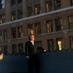 Downtown buildings' owner Billy Abraham property rich, cash poor, bankruptcy filing claims
