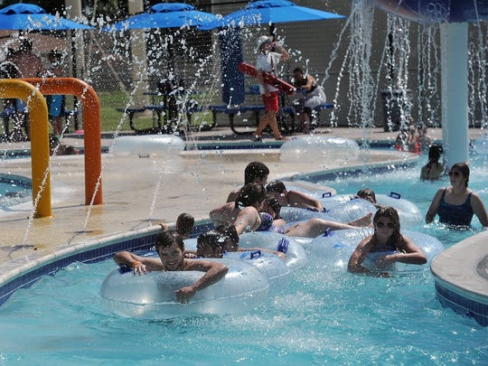 Nathan Acuna leads a tube train of friends and family on the Rustlin' Rapids River at the Boomtown Bay Family Aquatic Center in 2016.