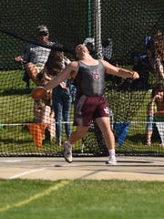 John Glenn's Louie Reicher thorws the discus Saturday during the Division II state track meet at Jesse Owens Memorial Stadium.