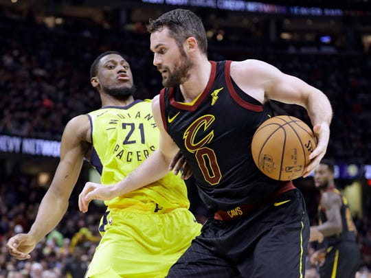 Cleveland Cavaliers' Kevin Love (0) drives to the basket