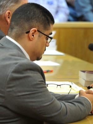 Juan Antonio Rodriguez listens while the prosecution questions an expert witness during Rodriquez's trial held in the 89th district courtroom Wednesday morning. Rodriguez is on trial for two counts of aggravated sexual assault of a child and one count of sexual assault of a child.