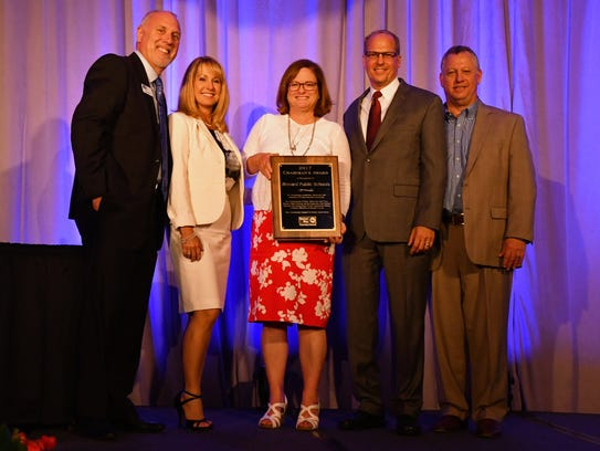 FILE PHOTO: Mark Mullins, second from right, helps receive the United Way Chairman's Award on behalf of Brevard Public Schools. He is joined by, left to right, United Way President Rob Rains, BPS assistant superintendents Stephanie Archer and Beth Thedy, and former FLORIDA TODAY publisher Jeff Kiel.