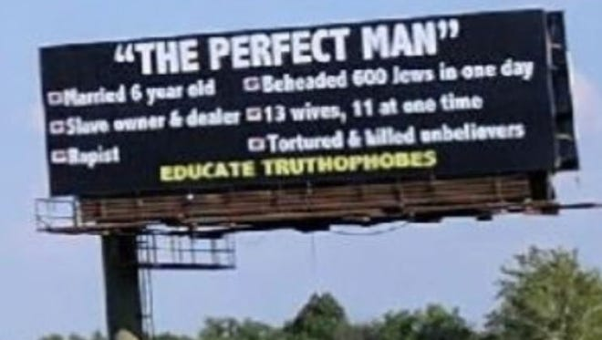 This photo of a billboard insulting The Prophet Muhammad was taken Friday on I-465 South near the Washington Street exit.