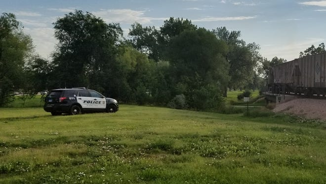 A Rapid City police vehicle sits near a train track where a man was struck.