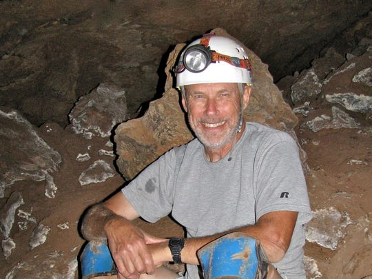 Doug Thompson takes a breather at Snowy River Cave in Lincoln County.