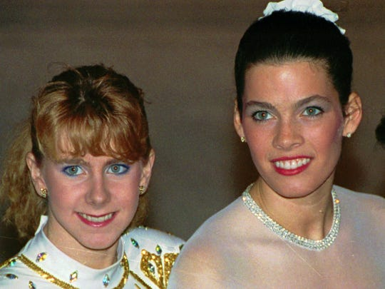 In this photo, taken Jan. 12, 1992, Tonya Harding, left, and Nancy Kerrigan appear at the U.S. Figure Skating Championships in Orlando, Fla. It's been nearly 20 years since Kerrigan was clubbed after practice at the U.S. figure skating nationals in Detroit by a member of a bumbling goon squad hired by Harding's ex-husband with the hope of eliminating his former wife's top competition for the 1994 U.S. Olympic team.