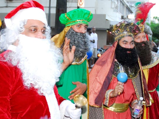 Santa and the Three Kings make an appearance at a street