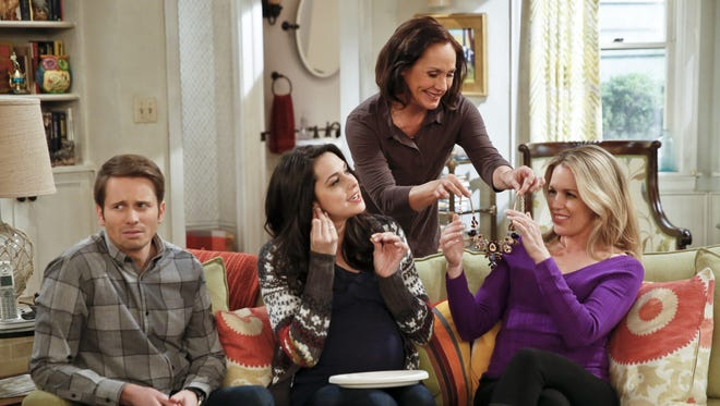 Tyler Ritter as Ronny, left, Kelen Coleman as Jackie, Laurie Metcalf as Marjorie and Jessica St. Claire as Katrina are in the  middle of a family gathering on 'The McCarthys.'