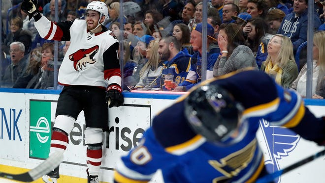 Arizona Coyotes' Brendan Perlini, left, celebrates after scoring as St. Louis Blues' Brayden Schenn, right, skates past during the first period of an NHL hockey game Saturday, Jan. 20, 2018, in St. Louis.