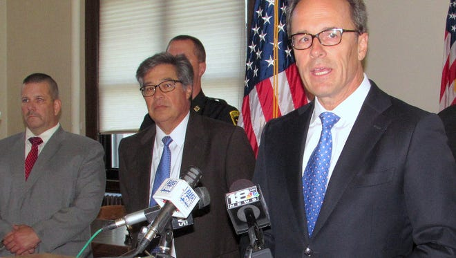 U.S. Attorney William Hochul announces federal drug charges against eight people during a Wednesday news conference at Elmira City Hall. Looking on are Chemung County District Attorney Weeden Wetmore, center, and Capt. Sean Holley, of the Chemung County Sheriff's Office.