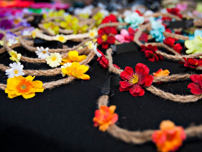 Flower headbands are laid out for display at the Kay & Jay Designs booth. Kay & Jay Designs is one of the many local artists and craftsmen at the First Friday Art Walk on June 6, 2014.
