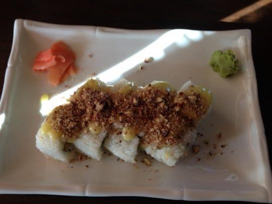 Fugu Tei's Stuart Beach Roll is tempura shrimp, avocado topped with chopped pecans and a honey wasabi sauce.