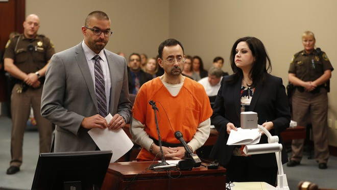 Larry Nassar, 54, appears in court for a plea hearing in Lansing, Mich., on Nov. 22, 2017. Nasser, a former sports doctor accused of molesting girls while working for USA Gymnastics and Michigan State University, pleaded guilty to multiple charges of sexual assault.