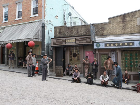 "Filming for the Cinemax series ""The Knick"" on May 6 on Elm and Oak streets in Yonkers, which were transformed with old-time facades, dirt roads and horse and buggies."