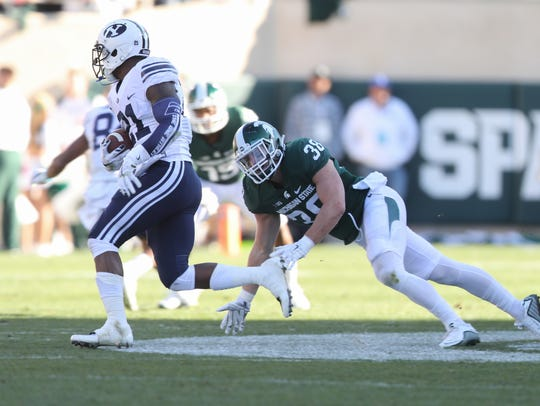 Michigan State Spartans Byron Bullough chases BYU Cougars