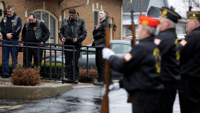 Mourners gather during the funeral service with full Military Honors for Michael L. Funk, in Oshkosh, Wis., Sunday, December 13, 2015. Funk, 60, died Dec. 5 after he was shot at by police. Funk had exited Eagle Nation Cycles, where a man had taken him and two others hostage. Police said he had a gun in his hand and did not obey commands to put the weapon down. Ron Page/Post-Crescent Media