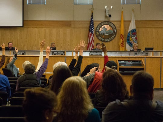 Hands raised by county residents when asked by County Commissioner Isabella Solis who wanted to make public remarks about County Manager Julia Brown. Tuesday, February 14, 2017.