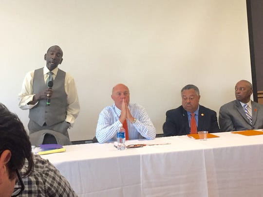 Clemson University's new chief diversity officer, Lee Gill, speaks as President Jim Clements and other university officials, staff and faculty listen at a forum on diversity Wednesday.