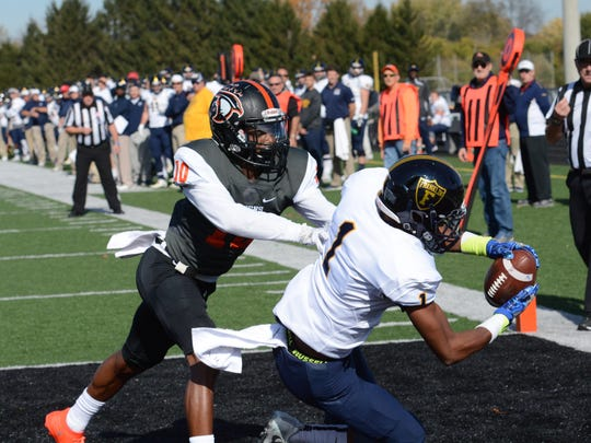 Deontez Alexander hauls in one of his three touchdown receptions Saturday against Anderson. The Grizzlies won 55-34.