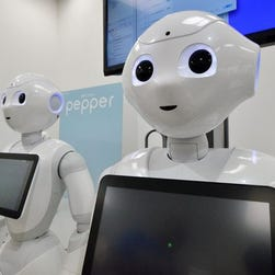 """Japanese mobile communication giant Softbank's humanoid robot """"Pepper"""" is displayed at a high-tech gadgets exhibition in Tokyo."""