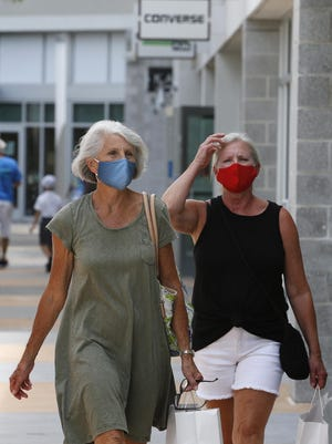 Shoppers wear masks while shopping this week at Tanger Outlets in Daytona Beach. New Smyrna Beach now has a similar mask rule to the one in Daytona Beach.