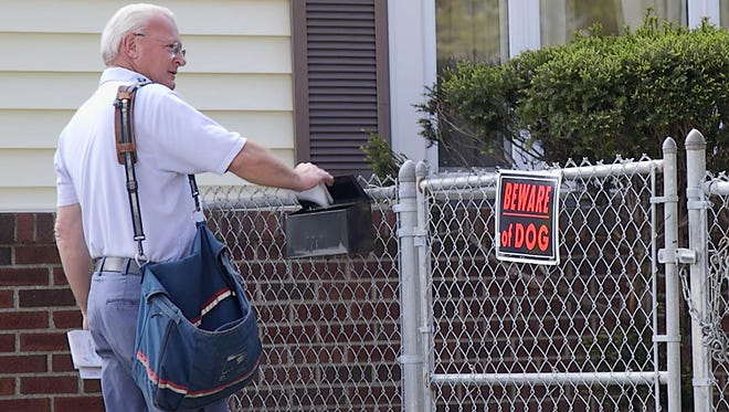 USPS letter carrier, Jo DiPasquale, on his route in Rochester where he was recently bitten by a dog.