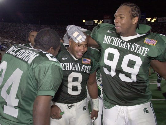 MSU's T.J. Duckett, center, celebrates on the field