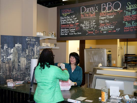 Kelly Orteza gives a customer a take out lunch at Danny's