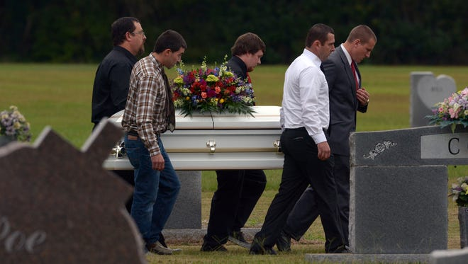 Pallbearers carry the body of  6-year-old Jeremy Mardis to the gravesite at Beaumont Cemetery in Beaumont, Mississippi, 30 miles East of Hattiesburg, Nov. 9, 2015. Jeremy Mardis, a 6-year-old autistic boy, was killed and his father wounded when marshals opened fire on their vehicle in Marksville, Louisiana.