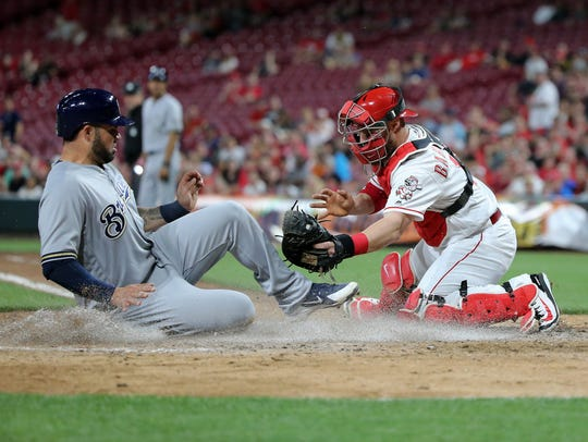 Milwaukee Brewers catcher Manny Pina (9) scores as