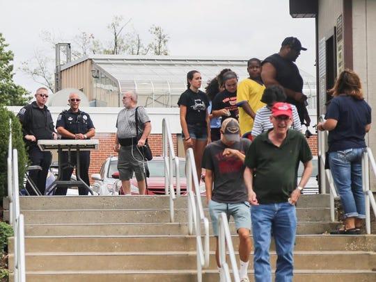 Spring Garden Township Police officers, left, talk