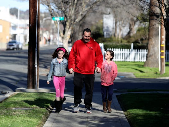 Stephen Bogisich, center walks to the store in Oroville