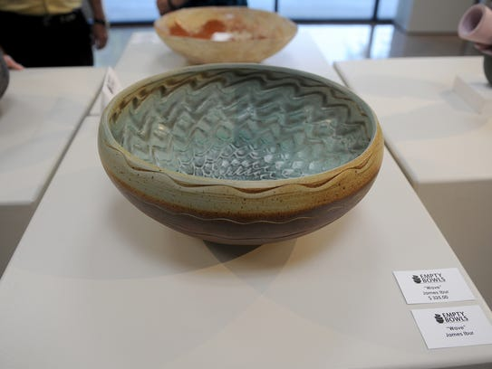 A ceramic bowl is displayed at the Empty Bowls Gallery