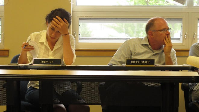 Burlington Planning Commissioners Emily Lee and Bruce Baker puzzle over proposed changes to downtown zoning on Tuesday at the Department of Public Works on Pine Street.
