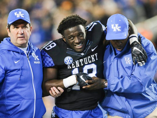 Kentucky running back Stanley Williams is helped off the field after an injury during the first half of an NCAA college football game against Tennessee, Saturday, Oct. 31, 2015, in Lexington, Ky.