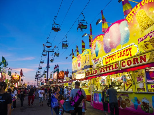 Visitors at the Arizona State Fair walk under the Sky