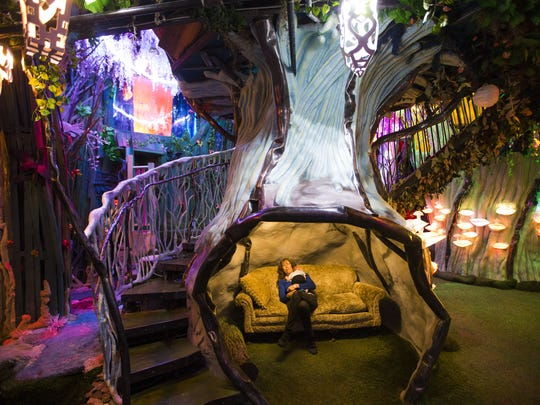 Guests explore at Meow Wolf in Santa Fe, New Mexico.