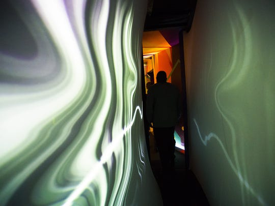 Guests explore at Meow Wolf in Santa Fe, New Mexico. Meow Wolf is an interactive art play space.